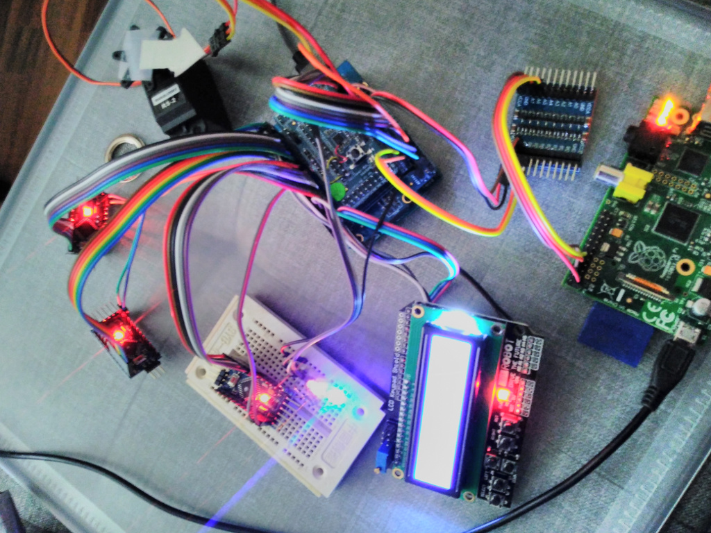 The iolinker board connected to four Arduinos, a Raspberry Pi, an LCD and a servo