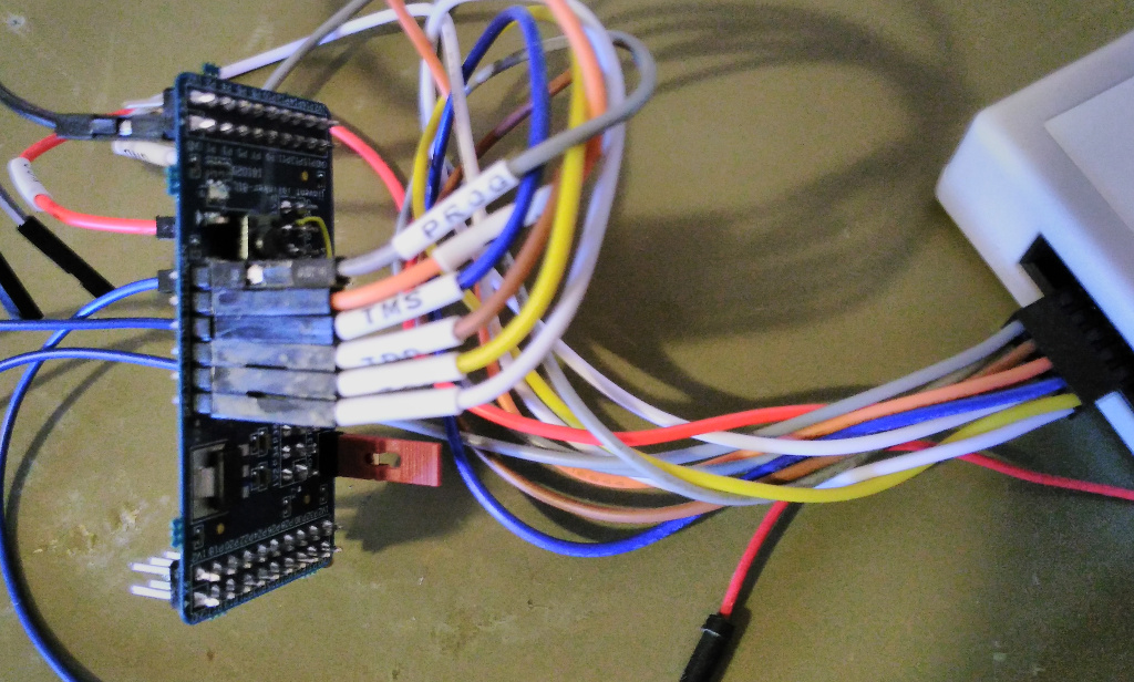 The iolinker board connected to the JTAG programming cable